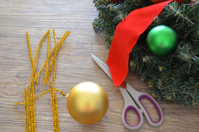 Cut your pipe cleaners in half and thread one end through your bauble or decoration.